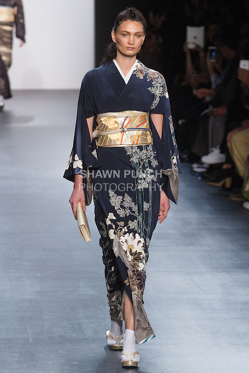 "Model walks runway in an ""Existence of the Universe"" silk kimono from the Hiromi Asai Fall Winter 2016 ""Spirit of the Earth"" collection by Hiromi Asai & Kimono Artisan Kyoto, presented at NYFW: The Shows Fall 2016, during New York Fashion Week Fall 2016."