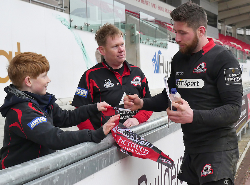 Young Edinburgh fan Samuel Massy gets his program signed by Edinburgh's Jack Cuthbert<br /> <br /> Photographer Ian Cook/CameraSport<br /> <br /> Rugby Union - Guinness PRO12 - Scarlets v Edinburgh - Saturday 28th March 2015 - Parc y Scarlets - Llanelli<br /> <br /> &copy; CameraSport - 43 Linden Ave. Countesthorpe. Leicester. England. LE8 5PG - Tel: +44 (0) 116 277 4147 - admin@camerasport.com - www.camerasport.com