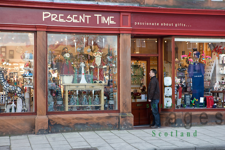 Moffat, gift shop front with shopper on the small town of Moffats High Street Dumfries and Galloway Scotland UK