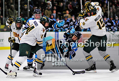 30 October 2010: University of Maine Black Bears' forward Brian Flynn, a Junior from Lynnfield, MA, is upended during game action against the University of Vermont Catamounts at Gutterson Fieldhouse in Burlington, Vermont. The Black Bears defeated the Catamounts 3-2 in sudden death overtime. Mandatory Credit: Ed Wolfstein Photo