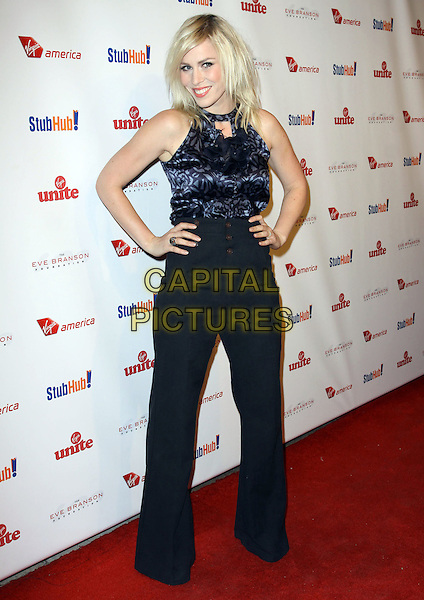 "NATASHA BEDINGFIELD .attending ""Rock The Kasbah"" held At Vibiana,  Los Angeles, California, USA, 26th October 2009..full length black navy blue hugh waisted trousers wide leg top sleeveless hands on hips print buttons grey gray ruffles cut out neck.CAP/ADM/KB.©Kevan Brooks/Admedia/Capital Pictures"