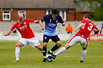 Yorkshire's Jack Normanton is tackled by Jersey's Luke Watson and Jay Giles. Yorkshire v Parishes of Jersey, CONIFA Heritage Cup, Ingfield Stadium, Ossett. Yorkshire's first competitive game. The Yorkshire International Football Association was formed in 2017 and accepted by CONIFA in 2018. Their first competative fixture saw them host Parishes of Jersey in the Heritage Cup at Ingfield stadium in Ossett. Yorkshire won 1-0 with a 93 minute goal in front of 521 people.