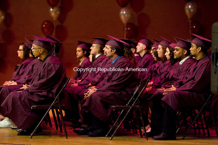 NAUGATUCK, CT - 20 MAY 2010 -052010JT13-<br /> Naugatuck Adult Education graduates sit on stage during Thursday's commencement exercises at Naugatuck High School. <br /> Josalee Thrift Republican-American