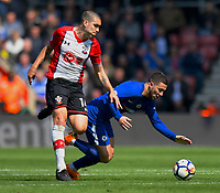 Chelsea's Eden Hazard (right) is tackled by Southampton's Oriol Romeu (left) <br /> <br /> Photographer David Horton/CameraSport<br /> <br /> The Premier League - Southampton v Chelsea - Saturday 14th April2018 - St Mary's Stadium - Southampton<br /> <br /> World Copyright &copy; 2018 CameraSport. All rights reserved. 43 Linden Ave. Countesthorpe. Leicester. England. LE8 5PG - Tel: +44 (0) 116 277 4147 - admin@camerasport.com - www.camerasport.com