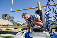NWA Democrat-Gazette/JASON IVESTER <br /> Bentonville junior running back Tyler Pike cools down on Friday, Aug. 7, 2015, during football practice at the Tiger Athletic Complex. Most of the area was under a heat advisory through the day.