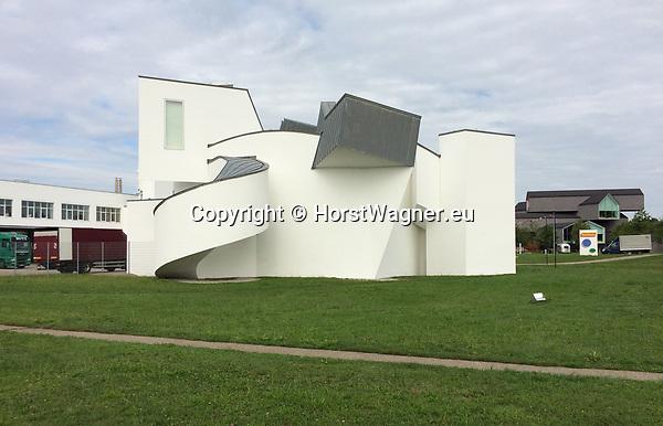 Germany, Weil am Rhein -- September 04, 2017 -- Vitra Campus, a production site (mainly furniture) and field of experimentation for architecture and design; here, the Vitra Design Museum, by Frank Gehry, and the VitraHaus (by Herzog & de Meuron), housing the Vitra Home Collection, in the back-right -- © HorstWagner.eu