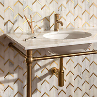Belen, a hand-cut stone mosaic, shown in polished Calacatta and brass brushed.
