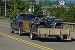Blue pickup towing quads in Florence, Oregon