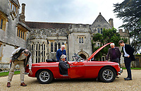 BNPS.co.uk (01202 558833)<br /> Pic: ZacharyCulpin/BNPS<br /> <br /> Autioneers and budding bidders inspect the red MG Roadster that featured in the film 'Sleuth'. It was driven by Michael Caine in the 1972 thriller.<br /> The car sold for £8000<br /> <br /> The contents of one of England's finest stately homes have sold at auction for close to £1.5m.<br /> <br /> The auction of a myriad of treasures inside Athelhampton House in Dorset was hailed as one of the best country house sales for a generation<br /> <br /> The collection of fine art, furniture, sculptures, paintings and rugs was amassed by three generations of the Cooke family who have just sold the £7m Tudor mansion