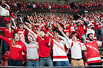 "Wisconsin Badgers fans sing ""Varsity""during an NCAA hockey game against the Alabama Huntsville Chargers at the Kohl Center in Madison, Wisconsin on October 15, 2010. The Badgers won 7-0. (Photo by David Stluka)"