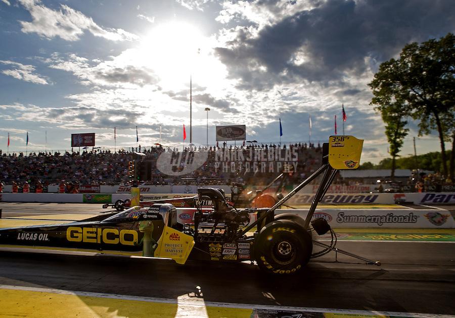 May 30, 2014; Englishtown, NJ, USA; NHRA top fuel driver Richie Crampton during qualifying for the Summernationals at Raceway Park. Mandatory Credit: Mark J. Rebilas-