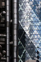 An abstract image of 30 St Mary's Axe Tower, also known as the Gherkin, and the Lloyd's building. London, UK May 1st 2008