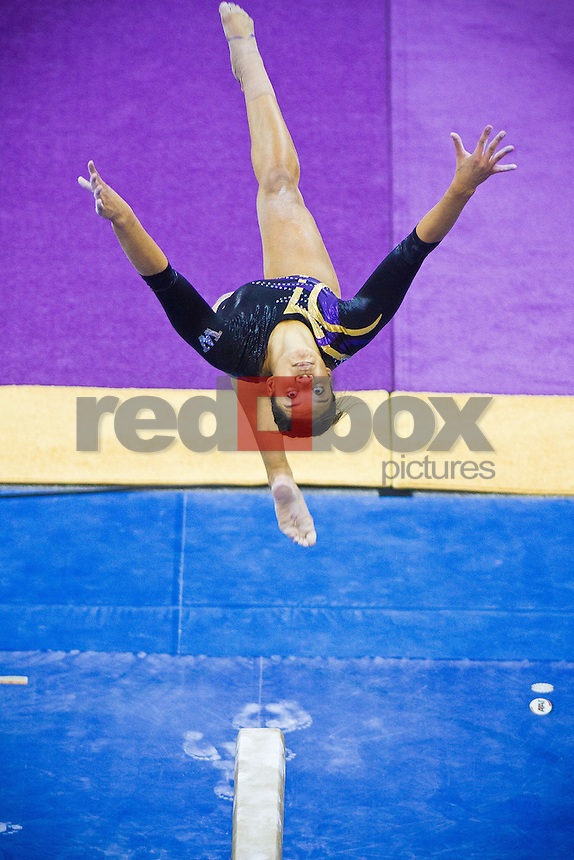 Doris Lynk - The University of Washington gymnastics team competes in their annual intrasquad meet at Alaska Airlines Arena Saturday, Dec. 11, 2011. (Photography by Andy Rogers/Red Box Pictures)