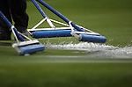 NEWPORT, WALES - OCTOBER 1: Workers squeegy a flooded green on the course during the 2010 Ryder Cup at the Celtic Manor Resort on October 1, 2010 in Newport, Wales. (Photo by Donald Miralle)