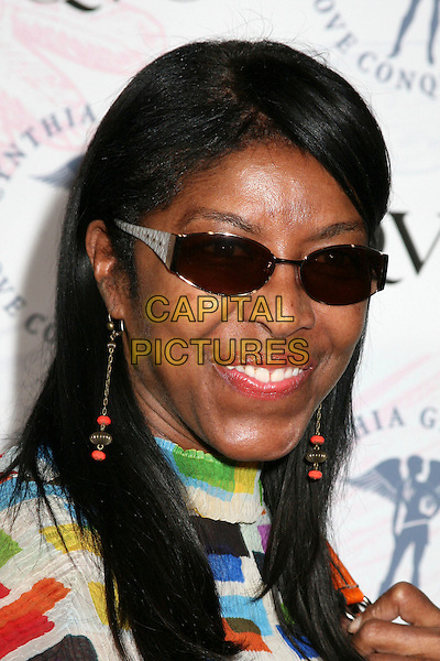 NATALIE COLE<br /> QVC and Cynthia Garrett Celebrate Her &quot;Love Conquers All&quot; Jewelry Collection Debut, Hollywood, California, USA.<br /> August 22nd, 2006<br /> Ref: ADM/BP<br /> headshot portrait sunglasses shades<br /> www.capitalpictures.com<br /> sales@capitalpictures.com<br /> &copy;Byron Purvis/AdMedia/Capital Pictures