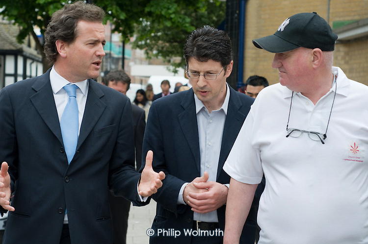 Conservative MP Nick Hurd, newly appointed Minister for Civil Society, talks with Neighbourhood Manager Marco Torquati and Community Engagement Officer John MacDonald during a visit to projects in Church Street, London,  supported by the Paddington Development Trust.
