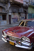red oldtimer, in the background graffiti