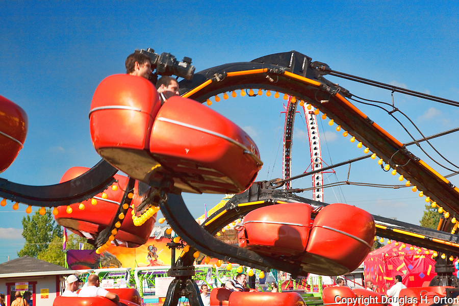 Midway rides bring thrills to fairgoers at The Puyalup Fair.  Western Washington State Fair.