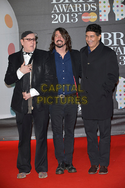 Sound City Players (Pat Smear, Dave Grohl, Rick Nielsen.The Brit Awards 2013 arrivals at the O2, Greenwich, London, England 20th February 2013.The Brits full length  blue shirt black coat  tie bow glasses scarf .CAP/PL.©Phil Loftus/Capital Pictures.