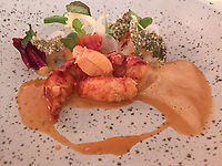 Second course of Breton lobster, salad and citrus fruit at Ecco St Moritz. Photo Sydney Low