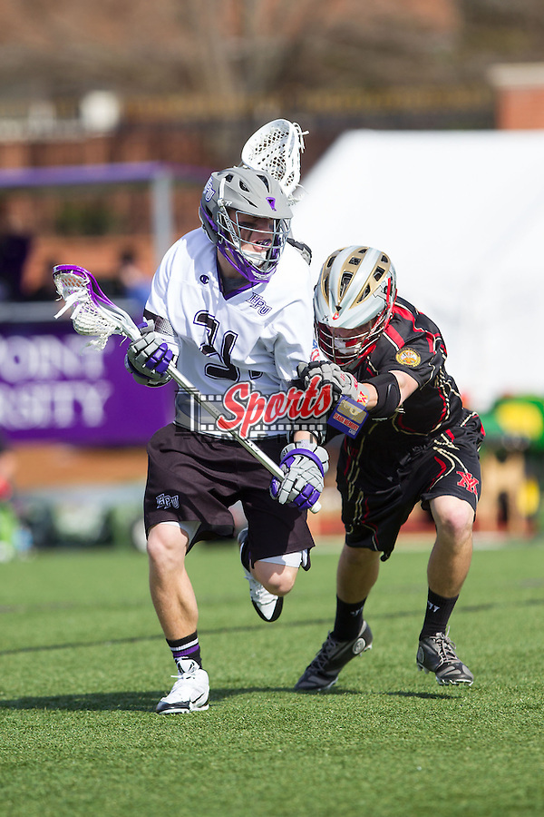 Matt Koerner (31) of the High Point Panthers is checked by a VMI Keydets defender at Vert Track, Soccer & Lacrosse Stadium on March 8, 2014 in High Point, North Carolina.  The Panthers defeated the Keydets 9-8.   (Brian Westerholt/Sports On Film)