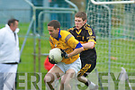 Derek Galvin (Feale Rangers) shields the ball from David O'Leary (Dr Crokes) in their County Championship Semi-final at Austin Stack park on Sunday.