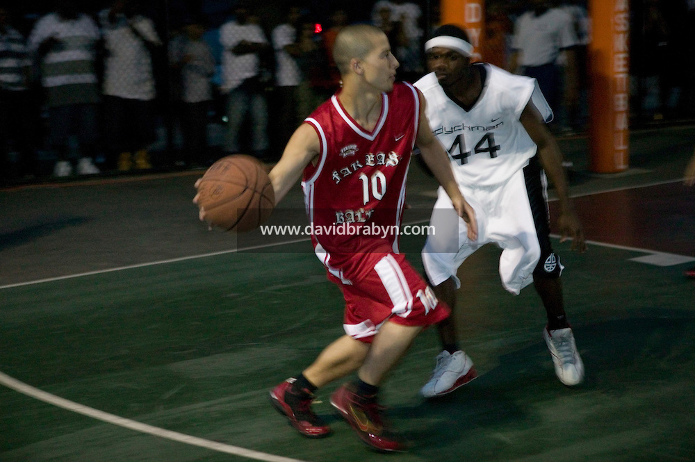 The Far East Ballers, a Japanese street basketball team, play a game against a local team in the Dyckman Tournament, New York City, USA, June 15 2005.