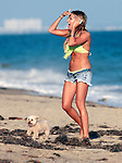 July 2nd 2012 Ashley Tisdale wearing a lime yellow bikini top and short jean shorts daisy dukes celebrating her 27th  birthday on the beach in Malibu California.  Ashley brought her dog & invited celebrity friends like Selena Gomez & boyfriend Scott Speer. AbilityFilms@yahoo.com805-427-3519www.AbilityFilms.com