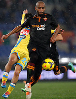 Calcio, semifinale di andata di Coppa Italia: Roma vs Napoli. Roma, stadio Olimpico, 5 febbraio 2014.<br /> AS Roma defender Maicon, foreground, is challenged by Napoli forward Lorenzo Insigne, partially seen, during the Italian Cup first leg semifinal football match between AS Roma and Napoli at Rome's Olympic stadium, 5 FeBruary 2014.<br /> UPDATE IMAGES PRESS/Riccardo De Luca