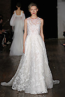 """Model walks runway in a """"Sometimes"""" bridal gown from the Alyne by Rita Vinieris Fall 2017 collection on October 7th, 2016 during New York Bridal Fashion Week."""