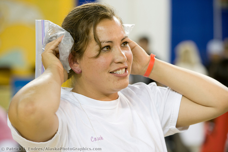 Pamela Nunooruk of Nome, Alaska in the ear pull  at the 2007 World Eskimo Indian Olympics, held in Anchorage, Alaska.