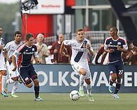 LA Galaxy substitute midfielder Robbie Rogers (14) brings the ball forward.  In a Major League Soccer (MLS) match, the New England Revolution (blue) defeated LA Galaxy (white), 5-0, at Gillette Stadium on June 2, 2013.