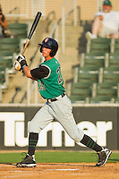 Daniel Cook #20 of the Augusta GreenJackets follows through on his swing against the Kannapolis Intimidators at Fieldcrest Cannon Stadium June 24, 2010, in Kannapolis, North Carolina.  Photo by Brian Westerholt / Four Seam Images
