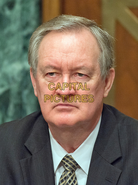 United States Senator Mike Crapo (Republican of Idaho) during the US Senate Committee on Banking, Housing, and Urban Affairs confirmation hearing on the nomination of Dr. Benjamin Carson to be Secretary of Housing and Urban Development (HUD) on Capitol Hill in Washington, DC on Thursday, January 12, 2017.<br /> CAP/MPI/RS/CNP<br /> &copy;RS/CNP/MPI/Capital Pictures