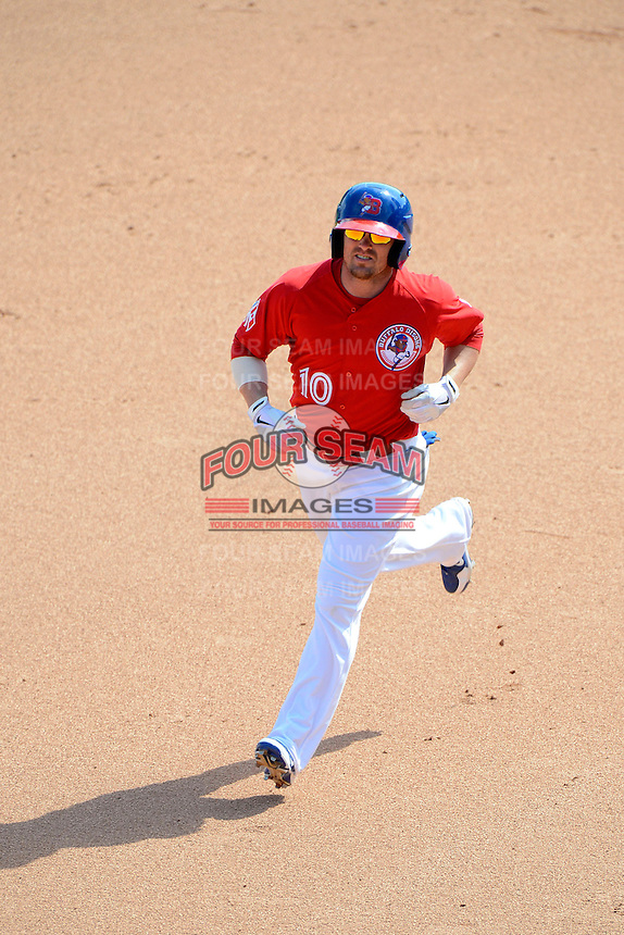 Buffalo Bisons shortstop Mike McCoy #10 runs the bases on a home run during the second game of a doubleheader against the Pawtucket Red Sox on April 25, 2013 at Coca-Cola Field in Buffalo, New York.  Buffalo defeated Pawtucket 4-0.  (Mike Janes/Four Seam Images)