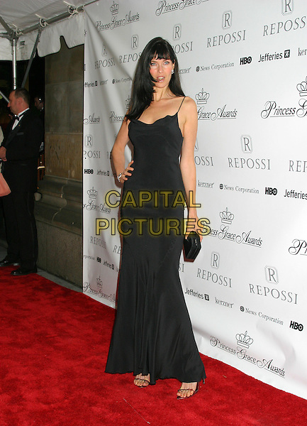 CAROL ALT.2004 Princess Grace Awards Gala - Arrivals.Cipriani's, New York City, New York .October 27, 2004.full length, black dress, hand on hip, clutch, purse, bag.www.capitalpictures.com.sales@capitalpictures.com.©Capital Pictures.