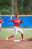 Philadelphia Phillies Jonathan Guzman (8) turns a double play during an Instructional League game against the Toronto Blue Jays on October 7, 2017 at the Englebert Complex in Dunedin, Florida.  (Mike Janes/Four Seam Images)