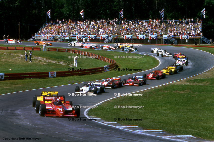 LEXINGTON, OH - SEPTEMBER 2: Mario Andretti leads the field enroute to victory in his  Lola T800/Cosworth during the CART IndyCar event on September 2, 1984, at the Mid-Ohio Sports Car Course near Lexington, Ohio.