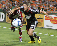Devon McTavish #18 of D.C. United pushes away Jair Benitez #5 of FC Dallas during an MLS match at RFK Stadium in Washington D.C. on August 14 2010. Dallas won 3-1.