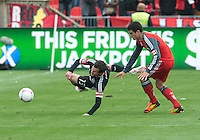06 October 2012: D.C. United midfielder/forward Chris Pontius #13 and Toronto FC defender Logan Emory #2 in action during an MLS game between DC United and Toronto FC at BMO Field in Toronto, Ontario Canada. .D.C. United won 1-0..