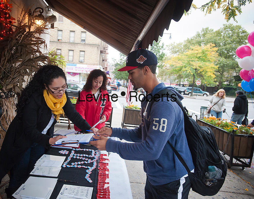 VotoLatino organizes a voter registration block fair on Dyckman Street in the Inwood neighborhood of New York on Sunday, October 7, 2012, 2012. The voting block of Hispanics has become increasingly important in both local and national elections.(© Richard B. Levine)