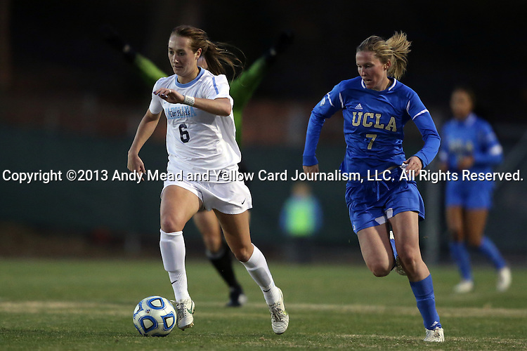 30 November 2013: North Carolina's Summer Green (6) is chased by UCLA's Jenna Richmond (7). The University of North Carolina Tar Heels played the University of California Los Angeles Bruins at Fetzer Field in Chapel Hill, North Carolina in a 2013 NCAA Division I Women's Soccer Tournament Quarterfinal match. UCLA won the game 1-0 in two overtimes.