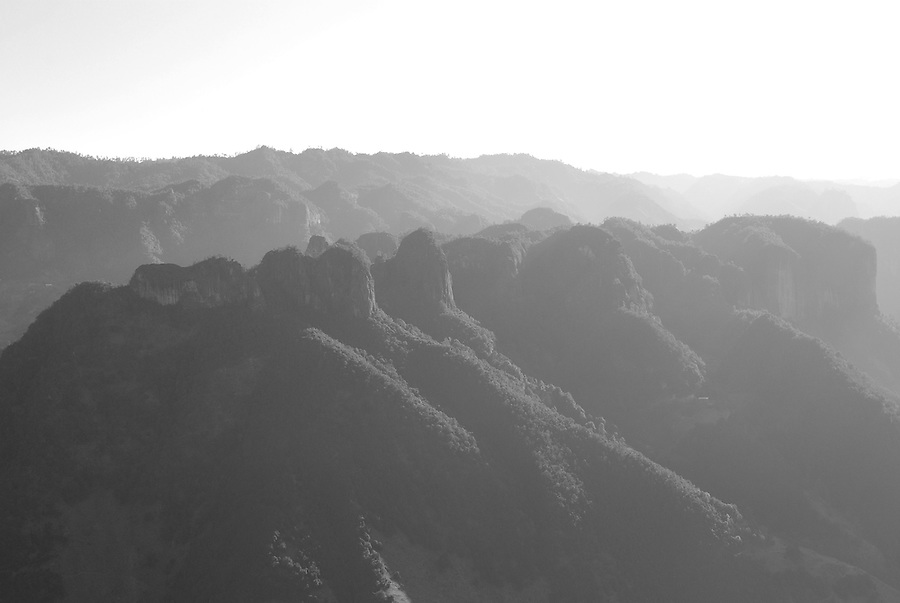 Peaceful and breathtaking scenery of morning mountains scene in black and white photography style. China nature fine art images taken by Paul Chong.