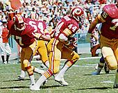 Washington Redskins running back John Riggins (44) takes a handoff from quarterback Billy Kilmer (17) against the New York Giants at RFK Stadium in Washington, D.C. on September 12, 1976.  The Redskins won the game 19 - 17..Credit: Arnie Sachs / CNP