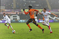 Kortney Hause of Wolverhampton Wanderers (C) chased by Connor Roberts of Swansea City during the Emirates FA Cup match between Swansea and Wolverhampton Wanderers at the Liberty Stadium, Swansea, Wales, UK. Wednesday 17 January 2018