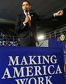 Elkhart, IN - February 9, 2009 -- United States President Barack Obama gestures as he speaks at a town hall meeting in Elkhart, Indiana, USA 09 February 2009. Obama is seeking public support for his economic stimulus plan by taking to the road to visit hard hit areas of the country. The unemployment rate in Elkhart is over 15%, triple the rate of December 2008..Credit: Tannen Maury - Pool via CNP.