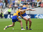 Shane O Donnell of Clare in action against Ronan Maher of Tipperary  during their quarter final at Pairc Ui Chaoimh. Photograph by John Kelly.
