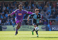 Joe Jacobson of Wycombe Wanderers heads forward under pressure from Reuben Reid of Plymouth Argyle during the Sky Bet League 2 match between Wycombe Wanderers and Plymouth Argyle at Adams Park, High Wycombe, England on 12 September 2015. Photo by Andy Rowland.