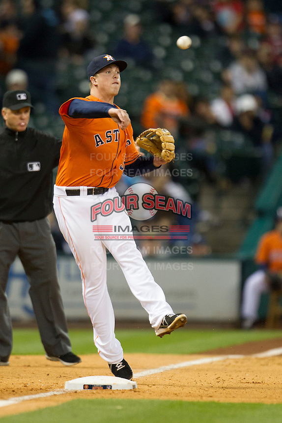 Houston Astros third baseman Matt Dominguez (30) makes an off balance throw to first base during the MLB baseball game against the Detroit Tigers on May 3, 2013 at Minute Maid Park in Houston, Texas. Detroit defeated Houston 4-3. (Andrew Woolley/Four Seam Images).