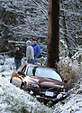 The first snow of the year finally swept across North Kitsap late Sunday as drivers were caught in a snowburst of precipitation.  The first rescue callout came on 104 for a stranded motorist, followed by 4 more cars further up the road on Ritter/104.  Gunderson quickly became an ice rink while drivers waited to follow a sanding truck down the steep incline. (OPG Photos/ Brad Camp)